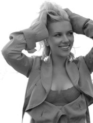 In this set of 5 pictures, Scarlett Johansson is happily wearing a red bra with an open shirt outside.